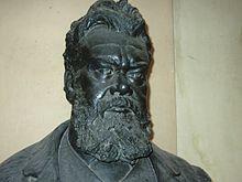 https://upload.wikimedia.org/wikipedia/commons/thumb/7/7f/Ludwig_Boltzmann_at_U_Vienna.JPG/220px-Ludwig_Boltzmann_at_U_Vienna.JPG