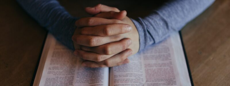 Bible with Hands