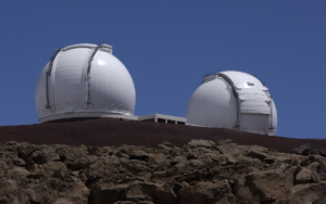 The Keck telescopes in Hawaii are some of the largest telescope in the world with 10 meter mirrors. They have helped in the observation of very distant objects in Universe.