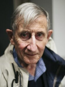 Freeman Dyson is a cosmologist writing about the finely tuned nature of the cosmos and how unlikely it would be to arise spontaneously.