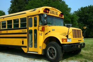 Busing was a program mandated by courts to achieve racial integration by busing students across school district lines.