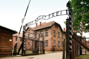 The Auschwitz concentration death camp was located in Poland where hundreds of thousands of people were killed.a