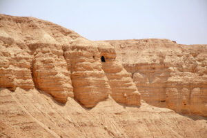 The Qumran Caves contained ancient scrolls wtores in clay jars, preserved by the arid climate of the desert for over two thousand years.